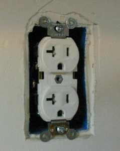 A duplex receptacle with the cover removed