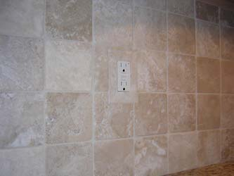Tiled in Durango travertine outlet cover plate